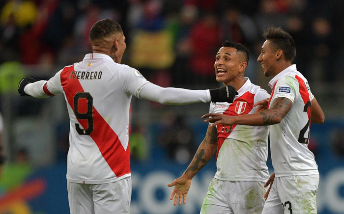 (L-R) Peru's Paolo Guerrero, Yoshimar Yotun and Christofer Gonzales celebrate after defeating Chile 3-0 in their Copa America football tournament semifinal match at the Gremio Arena in Porto Alegre, Brazil, on 3 July 2019. Picture: AFP