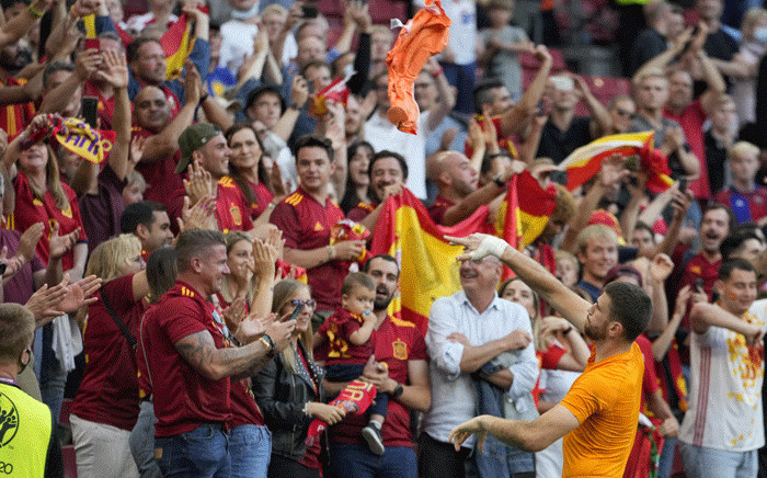 Spain's goalkeeper Unai Simon celebrates with fans their victory at the end of the Uefa Euro 2020 round of 16 football match between Croatia and Spain at the Parken Stadium in Copenhagen on 28 June 2021. Picture: Martin Meissner / POOL / AFP