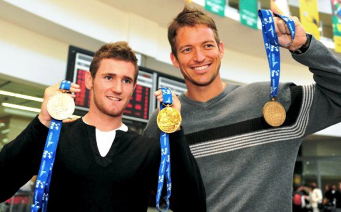 Cameron van der Burgh and Gerhard Zandberg at OR Tambo airport, 5 August 2009 after returning back from the FINA World Championships in Rome. Picture: Neil McCartney/SAPA