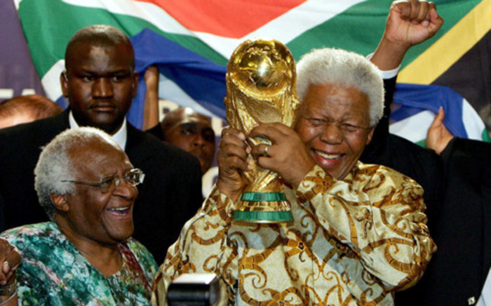 Former South African President Nelson Mandela (R) holding the Jules Rimet World cup beside Archbishop Desmond Tutu, at the FIFA headquarters in Zurich. Picture: AFP