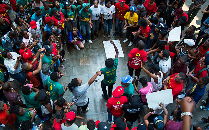 UWC students dance around burning tinder as they await the rector's speech regarding tuition fee increases. Picture: Anthony Molyneaux/EWN