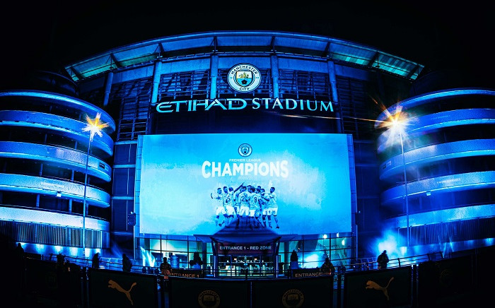 City joined the celebrations by unveiling a giant sky blue banner on the outside of the stadium once the final whistle blew in the United game. Picture: @ManCity/Twitter