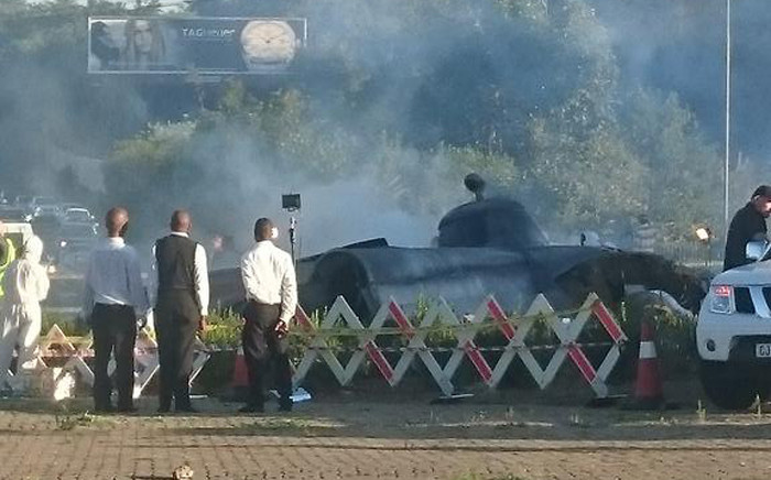 A movie scene in Sandton brought traffic to a halt this morning after scores of motorists took to social media to express shock in what appeared to be a helicopter crash. Picture: Julio Garcia ‏@juliogarciaSA