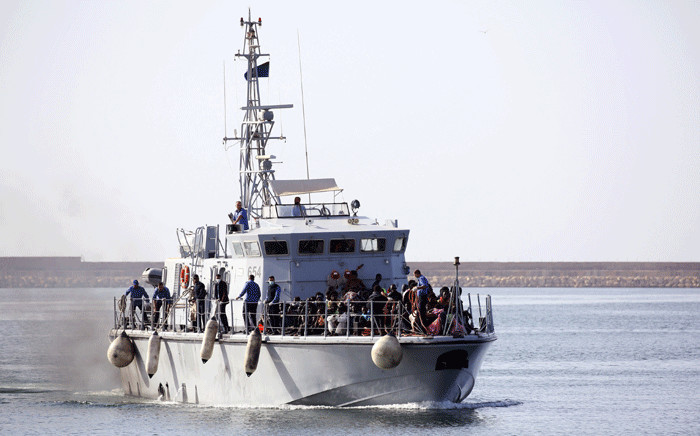FILE: Illegal migrants of different African nationalities arrive at a naval base in the capital Tripoli on 6 May 2018, after they were rescued from inflatable boat off the coast of Al-Zawiyah. Picture: AFP