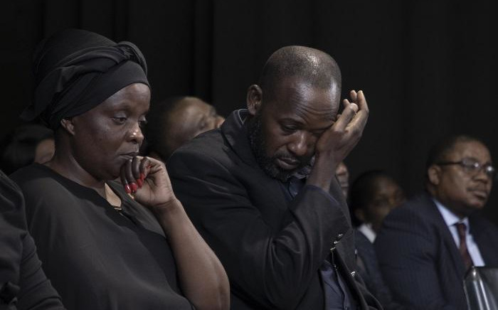 Anto Mpianzi and Ekila Guy Intamba, the parents of Enock Mpianzi, struggled to hold back their tears during a memorial service at Parktown Boys' High School on 29 January 2020. Picture: Xanderleigh Dookey/EWN