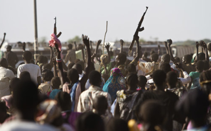 FILE: Sudan People's Liberation Army (SPLA) soldiers celebrate alongside internally displaced people outside the UN base in Malakal. Picture: AFP.