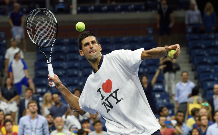 Novak Djokovic of Serbia hits balls to the fans after defeating Andreas Haider-Maurer of Austria during their US Open 2015 second round men's singles match at the USTA Billie Jean King National Center 2 September, 2015 in New York. Picture: AFP.