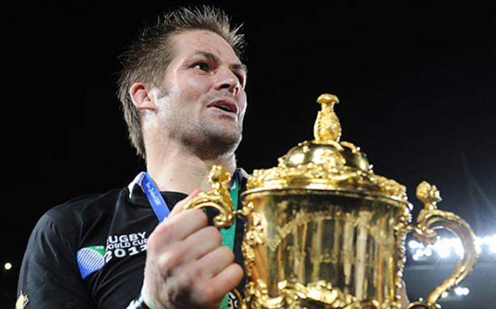 New Zealand captain Richie McCaw holds the Webb Ellis cup. Picture: AFP