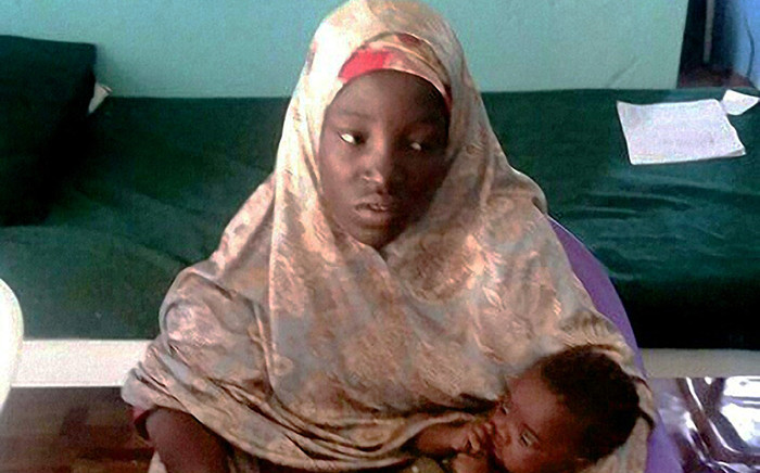 This handout picture taken in Damboa and released by the Nigerian army on 18 May, 2016 shows Amina Ali posing with her 4-month old baby Safiya, one of 219 girls abducted from their school in Chibok more than two years ago, after she was released by Nigeria's army. Picture: AFP.