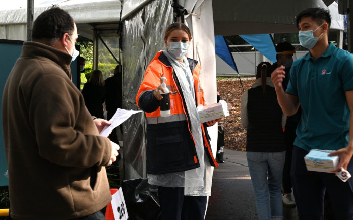 Sydneysiders queue outside a vaccination centre in Sydney on 29 June 2021, as about 10 million Australians have been ordered into lockdown as COVID-19 spreads across the country, after Brisbane became the fourth major city to issue stay-at-home orders. Picture: AFP