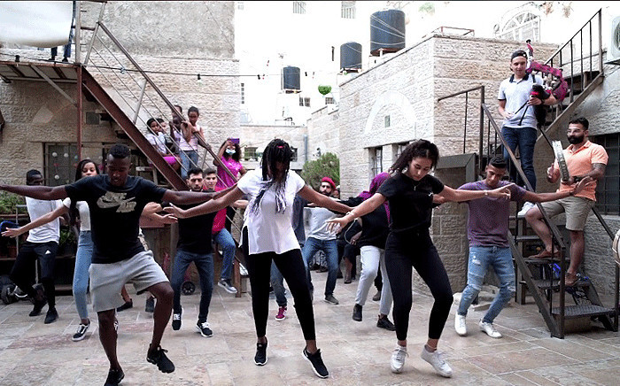 A screengrab via JAWS shows Palestinians taking part in the Jerusalema dance challenge.