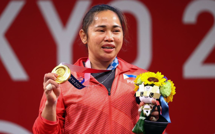 Weightlifter Hidilyn Diaz made history on Monday when she became the first athlete from the Philippines to win an Olympic gold medal. Picture: @Olympics/Twitter.