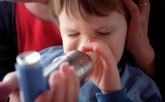 FILE: A child inhaling Ventolin to prevent an asthma attack. Picture: AFP.