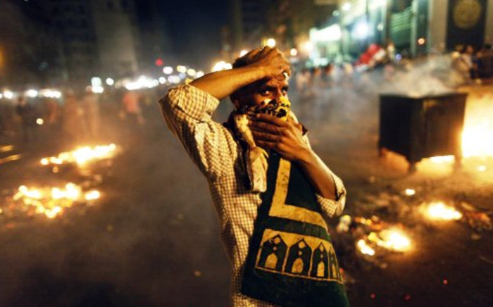 A supporter of the Muslim Brotherhood and of Egypt's ousted President Mohamed Morsi demonstrates on 16 July, 2013 in the centre of Cairo.Picture:AFP