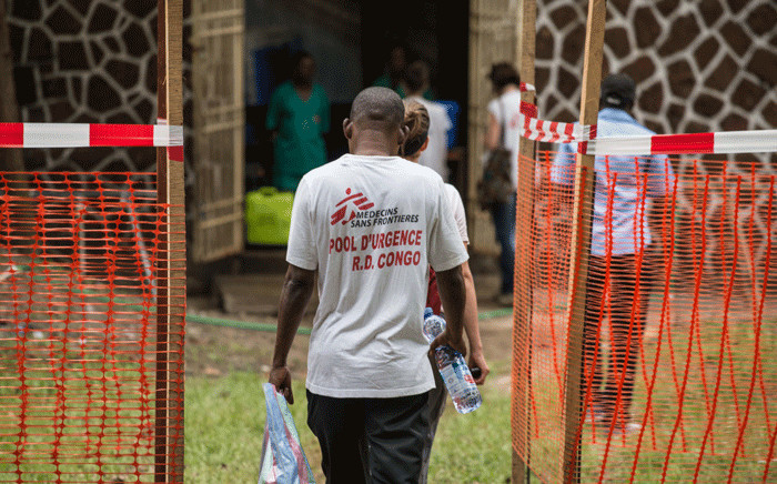 FILE: Doctors Without Borders (Medecins sans frontiere - MSF) team members walk through an Ebola security zone at the entrance of the Wangata Reference Hospital in Mbandaka, northwest of DR Congo on 20 May 2018. Picture: AFP