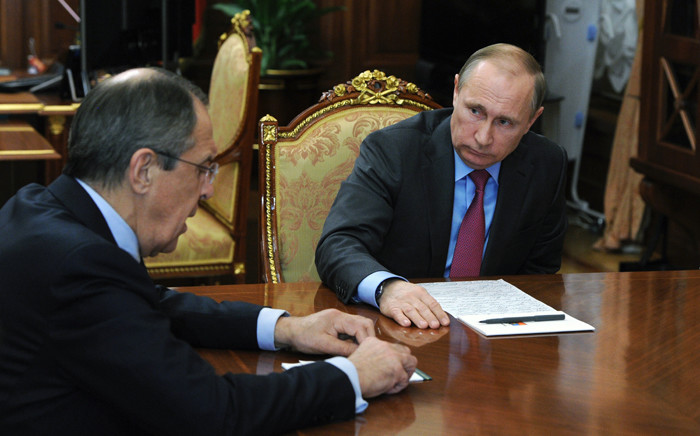 Russian President Vladimir Putin meets with Defence Minister Sergei Shoigu and Foreign Minister Sergei Lavrov at the Kremlin in Moscow on 14 March, 2016. Picture: AFP.