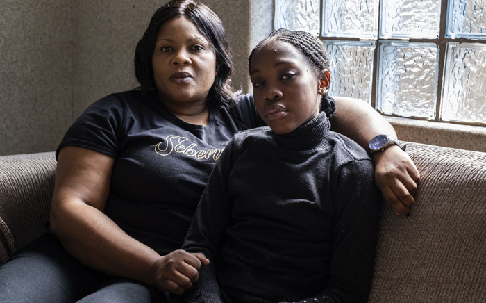 Tumelo Ledwaba (R), who is suffering from respiratory problems, and her mother, Nono Ledwaba, pose for a portrait in their house in eMpumelelweni Extension 6, near eMalahleni , part of the Highveld region turned over to mines and power plants, on 13 June 2019. Picture: AFP