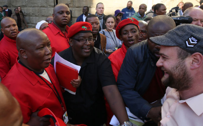 EFF leader Julius Malema (L) exchanges words with ANC Youth League national task team member Braam Hanekom (R) on Thursday, 21 August 2014. Picture: Sapa
