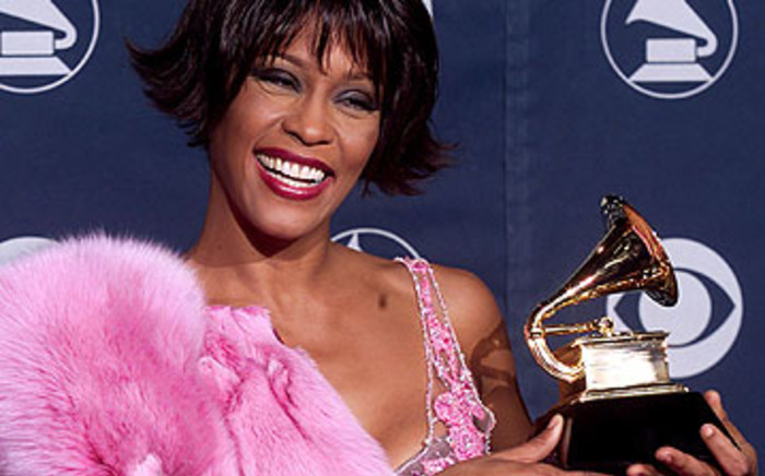 US singer Whitney Houston holding her Grammy award for Best Female Rythm and Blues Vocal Performance in 2000. Picture: AFP