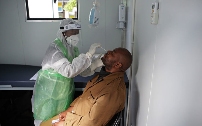 FILE: A City of Tshwane Health official takes a nasal swab to test for the COVID-19 coronavirus on a taxi operator at the Bloed Street Mall in Pretoria Central Business District, on 11 June 2020. Picture: AFP.