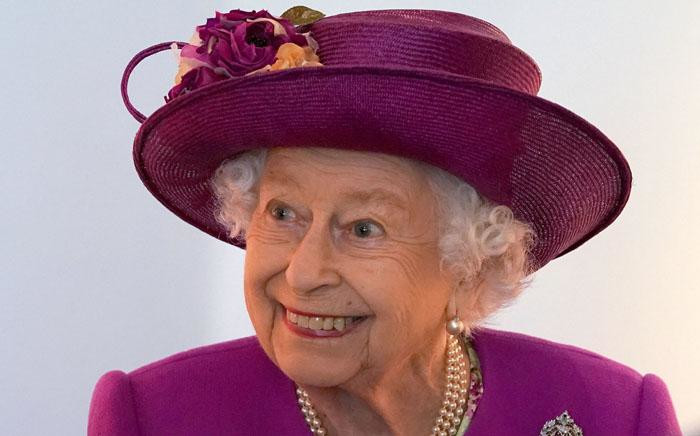 Britain's Queen Elizabeth II gestures as she views exhibits at the new Argyll and Sutherland Highlanders Museum at Stirling Castle, Stirling in Scotland on 29 June 2021, as part of her traditional trip to Scotland for Holyrood Week. Picture: Andrew Milligan/POOL/AFP