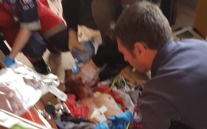 Paramedics attend to a man who was shot during another attempt to assassinate alleged gang boss Jerome 'Donkie' Booysen. Picture: Supplied.