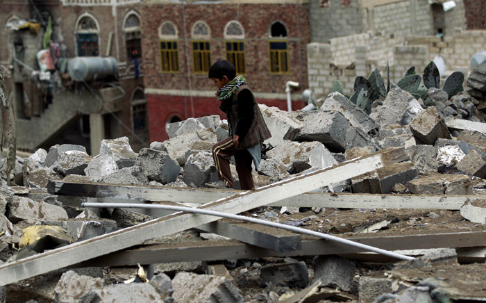 A Yemeni child inspects the rubble of a house in Yemen's rebel-held capital Sanaa on 11 August 2016, after it was reportedly hit by a Saudi-led coalition air strike. Saudi-led coalition jets pounded Shiite rebel positions in and around the Yemeni capital for the third consecutive day as a Saudi woman was killed by shelling from Yemen. Picture: AFP