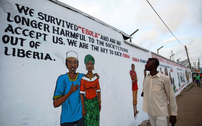 A Liberian man looks at an Ebola sensitisation campaign painted on a wall in downtown Monrovia, Liberia 19 November 2014. The government has increased Ebola sensitization despite the reduction of number of cases in the country. Ebola has infected around 14,000 people in West Africa with more than 5,000 deaths. Picture:EPA.