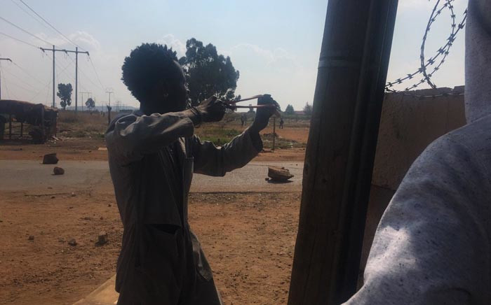 A Finetown protester seen with a slingshot during demonstrations over lack of houses. Picture: Mia Lindeque/EWN
