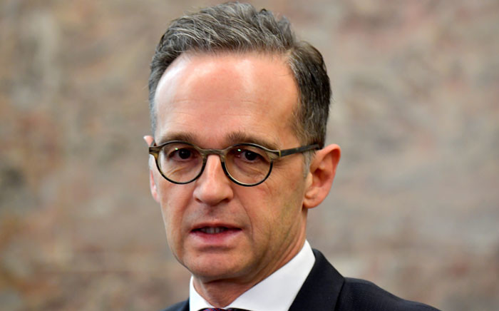 German Foreign Minister Heiko Maas talks to the press on novel coronavirus as he arrives for a meeting to review the roadmap's implementation of a joint initiative with France on the control of small arms and light weapons in the Western Balkans by 2024, on 31 January 2020 in Berlin. Picture: AFP