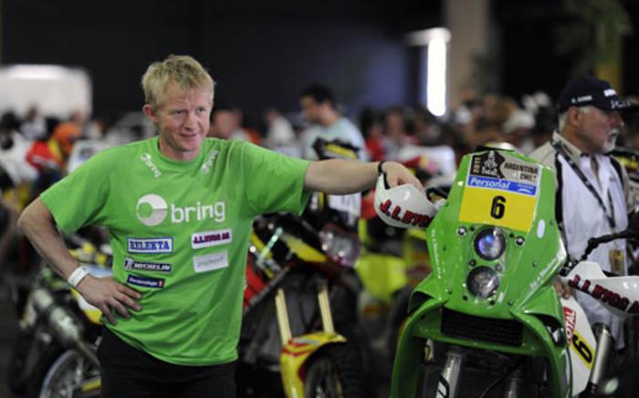 Pal-Anders Ullevalseter poses next to his KTM Bike. Picture: AFP