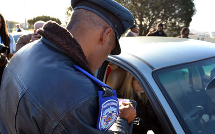 A motorist's cellphone impounded on the Nelson Mandela Boulevard on 5 July 2012. Picture: Aletta Gardner/EWN