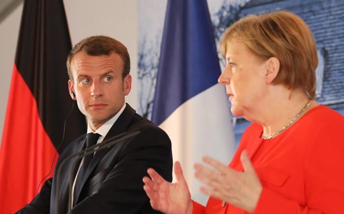 FILE: French President Emmanuel Macron (L) and German Chancellor Angela Merkel. Picture: AFP.