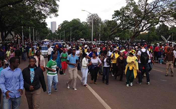 Mourners march to the Union Buildings in Pretoria where the body of Nelson Mandela lies for public viewing on 11 December 2013. Picture: Masego Rahlaga/EWN.
