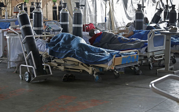 Patients are seen lying on hospital beds inside a temporary ward dedicated to the treatment of possible COVID-19 coronavirus patients at Steve Biko Academic Hospital in Pretoria on 11 January 2021. Picture: Phill Magakoe/AFP