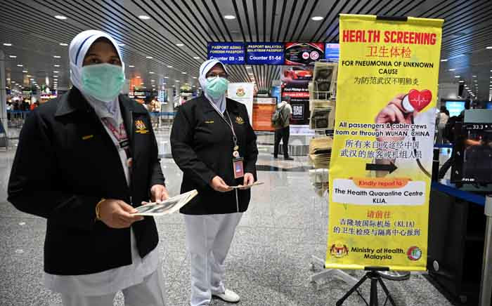 Malaysian health officers are deployed at Kuala Lumpur International Airport in Sepang on 21 January 2020 as authorities increased measures against the coronavirus. Picture: AFP.