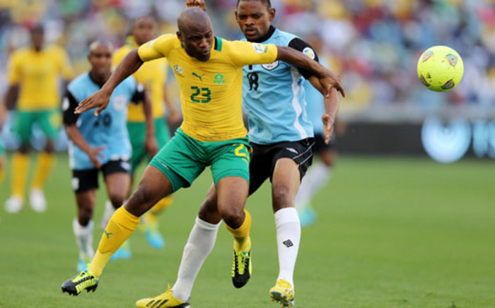 Bafana Bafana's Tokelo Rantie vies with Botswana's Mogogi Gabonamong during a 2014 Soccer World Cup Qualifying match at The Moses Mabhida Stadium in Durban on 7 September 2013. Picture: AFP.