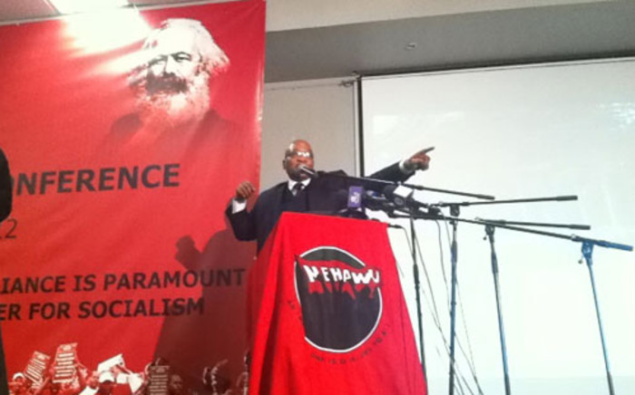 President Jacob Zuma sings Umshini Wami at the Nehawu policy conference on 10 June 2012 in Boksburg, Johannesburg. Picture: Gia Nicolaides/EWN