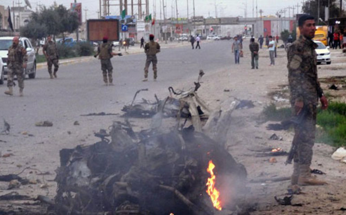 FILE: Iraqi security secure the area of a car bomb on March 16, 2013, in the northern city of Kirkuk, which injured some 18 people. Picture: AFP/ MARWAN IBRAHIM