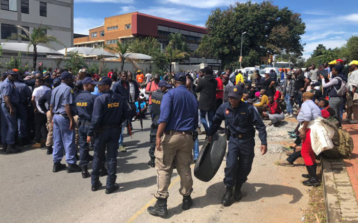 Police confiscate tyres from Alexandra protesters on the Grayston Bridge on 8 April 2019. Picture: Ayanda Nyathi/EWN