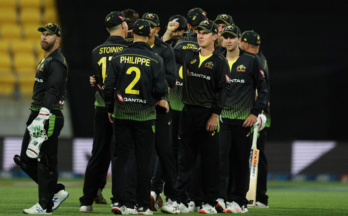 Australian players celebrate their win during the third Twenty20 cricket match between New Zealand and Australia in Wellington on 3 March 2021.Picture: Marty Melville/AFP