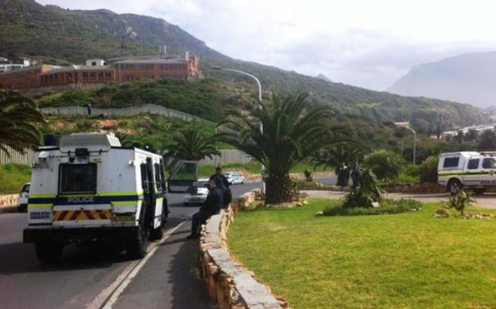 A police van parked outside block of flats in Hangberg on 30 September 2014 following violent protests in the area. Picture: Chanel September/EWN.