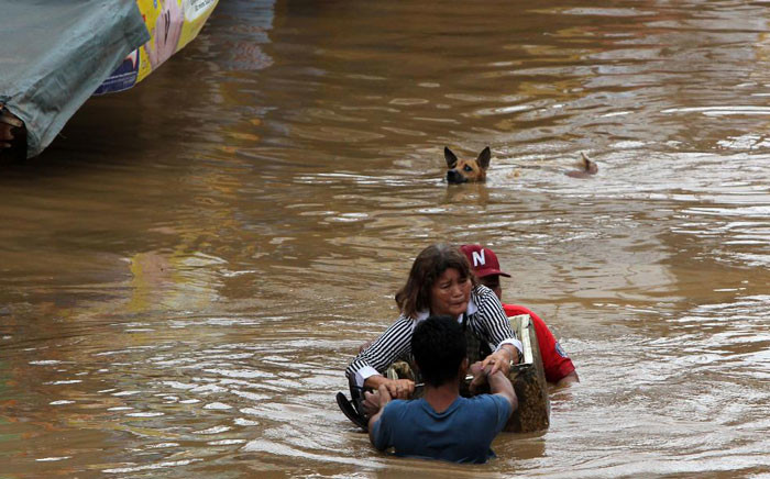 Rescuers in the Philippines searched on Sunday for survivors of a storm that triggered floods and landslides. Picture: CNN screengrab.