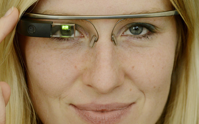 A model wears a prototype Google Glass during a presentation. Picture: EPA.