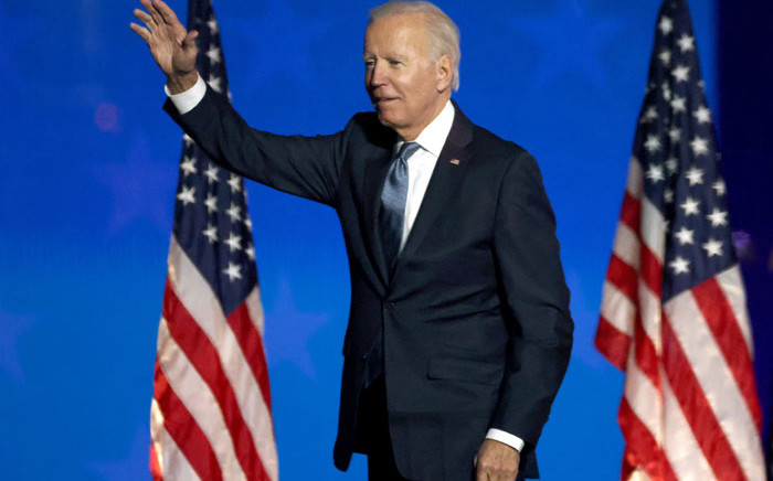 Democratic presidential nominee Joe Biden speaks at a drive-in election night event at the Chase Center in the early morning hours of 4 November 2020 in Wilmington, Delaware. Picture: AFP