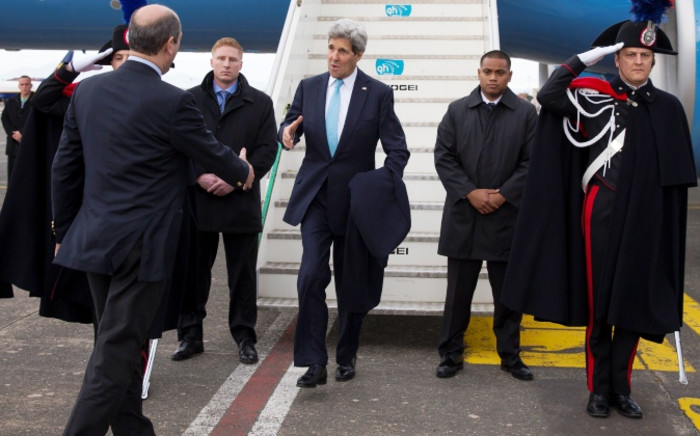 FILE: US Secretary of State John Kerry (C) arrives at Ciampino International Airport, on 14 December, 2014, in Rome. Picture: AFP.