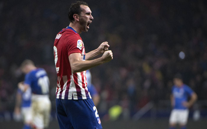 Atletico Madrid's Uruguayan defender Diego Godin celebrates after scoring during the Spanish league football match between Club Atletico de Madrid and Athletic Club Bilbao at the Wanda Metropolitano stadium in Madrid on 10 November 2018. Picture: AFP.