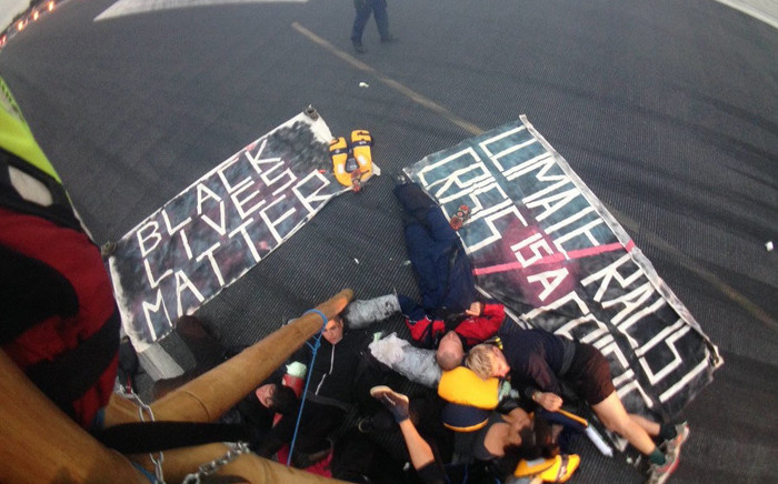 """Members of """"Black Lives Matter"""" during a protest on a runway at London City Airport. Picture: Twitter/@ukblm."""