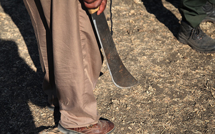 A man is wielding a panga around Marikana where violence at the Lonmin mines on 14 August, 2012. Around 3000 drill operators down tools during a illegal strike. Picture: Taurai Maduna/Eyewitness News.