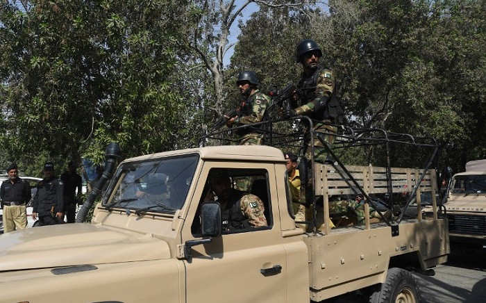 Pakistani army soldiers patrol at the Chinese consulate after an attack in Karachi on 23 November 2018. Picture: AFP